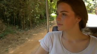 Backpacking young tourist girl traveling in tuk tuk in asia Cambodia