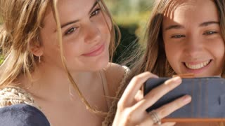 Best friends teen selfie shots with mobile phone cheerful face expression