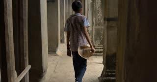 Boy walking Angkor Wat Cambodia ancient civilization temple
