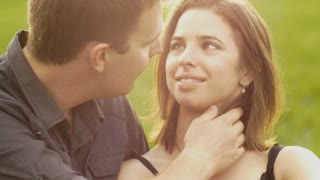 Boyfriend girlfriend young couple in love park sunset slow motion
