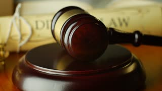 Court house gavel magistrate judge pronouncing a divorce settlement