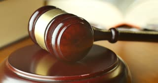 Court house gavel used by magistrate judge pronouncing a settlement