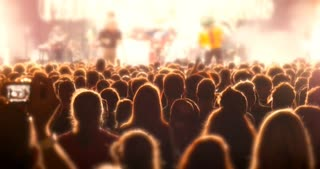 Crowd partying at rock concert festival stage event