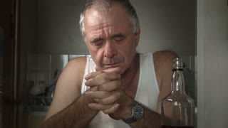 Crying depressed adult male person suffering Alcoholism and Loneliness