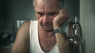 Depressed adult male person crying suffering Alcoholism and Loneliness