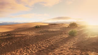Desert sand dunes ripple with morning light cloudy sky timelapse