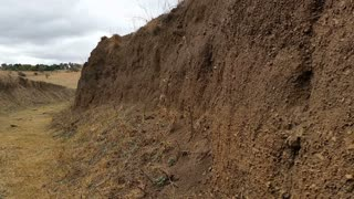 Erosion is the action of exogenic processes (such as water flow or wind) which remove soil and rock from one location on the Earth's crust, then transport it to another location where it is deposited.