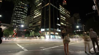 Establishing shot City Street Night Traffic and Pedestrian Time Lapse - 4K