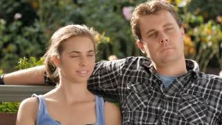 First date romantic couple girlfriend kisses boyfriend gazes lovingly