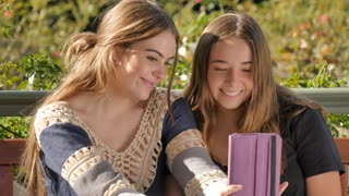 Generation z girls using a wireless tablet pc computer to take selfie photo