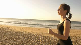 Girl running outdoors jogging to increase fitness through exercise slow motion