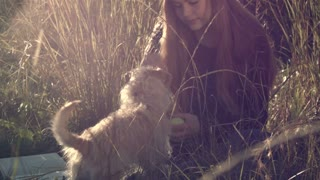 girl with cute pet dog outdoors