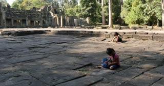 Girls playing Cambodia Angkor Wat temple ancient ruin buildings Preah Khan