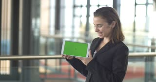 Green screen tablet PC smiling business person in office sales customer service