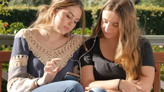 Happy best friend teenage girls listening to music together lifestyle friendship