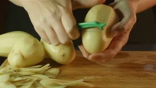 healthy fresh food prep cutting up of vegetable pumpkin potato in kitchen