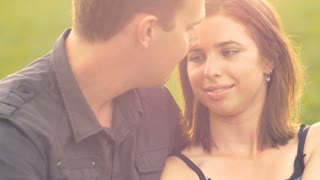 Heterosexual Young couple in love park sunset slow motion lifestyle