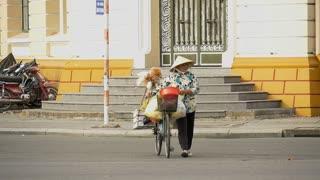HO CHI MINH / SAIGON, VIETNAM - 2015: Crossing road in busy asian city