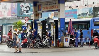 HO CHI MINH / SAIGON, VIETNAM - 2015: petrol prices refueling gas station asia