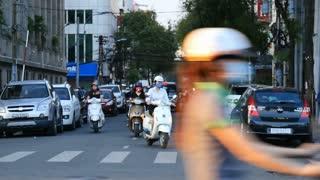 HO CHI MINH / SAIGON, VIETNAM - 2015: Streets busy asian city life slow motion