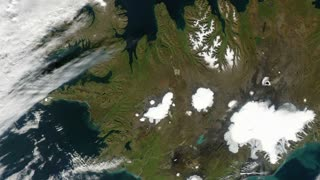 Iceland from space - slow pan. Iceland is a Nordic country between the North Atlantic and the Arctic Ocean.