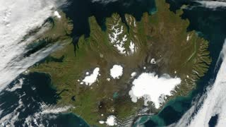 Iceland from space - slow zoom. Iceland is a Nordic country between the North Atlantic and the Arctic Ocean.