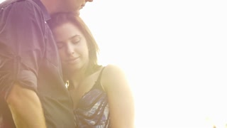 Kissing romance of a young couple in love park sunset slow motion lifestyle