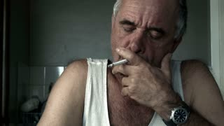 lighting and smoking a cigarette adult male with drug tobacco addiction