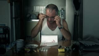 Male adult man suffering stress of unpaid invoice financial bill and money debt