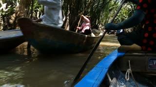MEKONG DELTA, VIETNAM - 2015: Vietnamese boat lady southern Vietnam