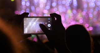 Mobile smart phone used by fan at rock concert event