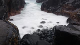 Moody ocean sea waves breaking on coastal beach / rock platform, with the use of a slowshutter effect this would make for a dreamy surreal seascape background. Filmed at Kiama, NSW, Australia