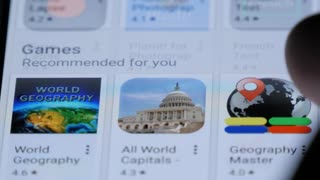 NEW YORK, USA - MAY 2016: Browse mobile app store on smart phone device