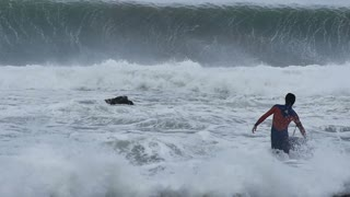NSW, AUSTRALIA - JUNE 2016: bodyboarder surfer massive waves stormy sea