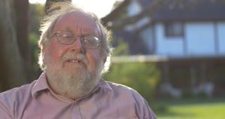 Portrait of grandfather elderly retired senior man at retirement age outdoors
