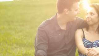 Portrait of young couple in love hugging being happy outdoors sunset