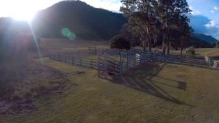 Racing drone quad copter flying FPV rural Australia aerial farm footage