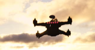 Racing multirotor drone quadcopter aircraft flying in sky via remote control