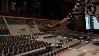 Recording music studio engineer mixing board sound desk in recording studio