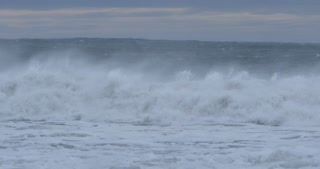 Rough ocean sea with big waves swells during stormy weather