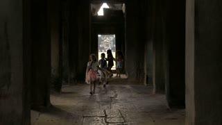 SIEM REAP, CAMBODIA - NOVEMBER 2015: Cambodian children walking through temple