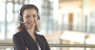 Smiling call center customer service support operator receptionist woman headset