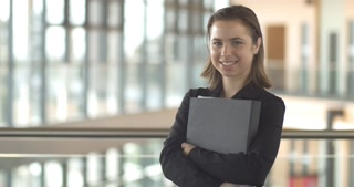 Smiling corporate businesswoman successful confident professional portrait with folder