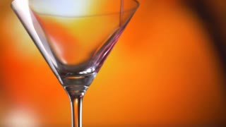 Soft drink Cocktail soda pour into glass slowmotion on colorful background