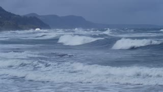 Stormy Ocean Sea with Crashing Waves on rocks and Cyclone Hurricane Winds