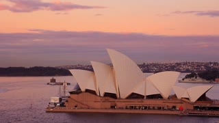 Sydney Opera House sunset is located near Circular Quay, a harbour in Sydney, New South Wales, Australia on the northern edge of the Sydney central business district on Sydney Cove