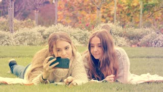 Teenage girls enjoying taking selfie on mobile smart phone technology