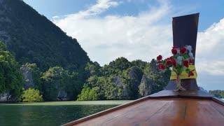 Thailand Longboat through limestone islands