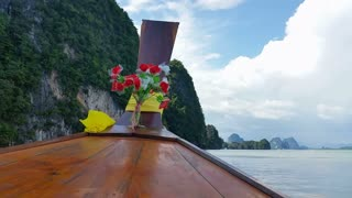 Thailand Longboat through limestone islands