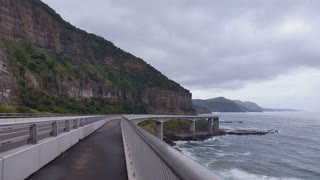 The Sea Cliff Bridge is a balanced cantilever bridge located in the northern Illawarra region of New South Wales, Australia. The $52 million bridge links the coastal villages of Coalcliff and Clifton. Slow shutter effect used.